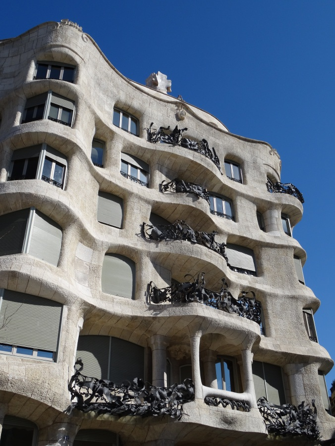 Exterior view of Casa Mila's stone and wrought iron balconies, Barcelona