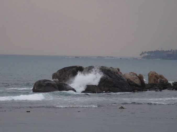 Waves crashing at sunset around Galle Fort