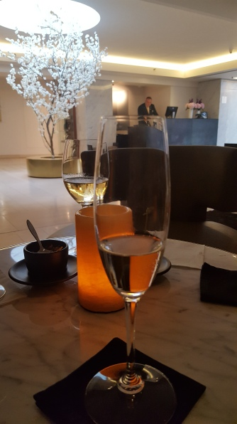 Enjoying some champagne before dinner, Mandarin Oriental hotel lobby, Prague