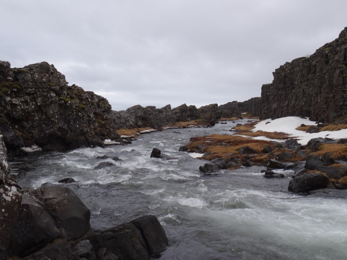 The river running away from Öxarárfoss falls at Þingvellir National Park, Iceland
