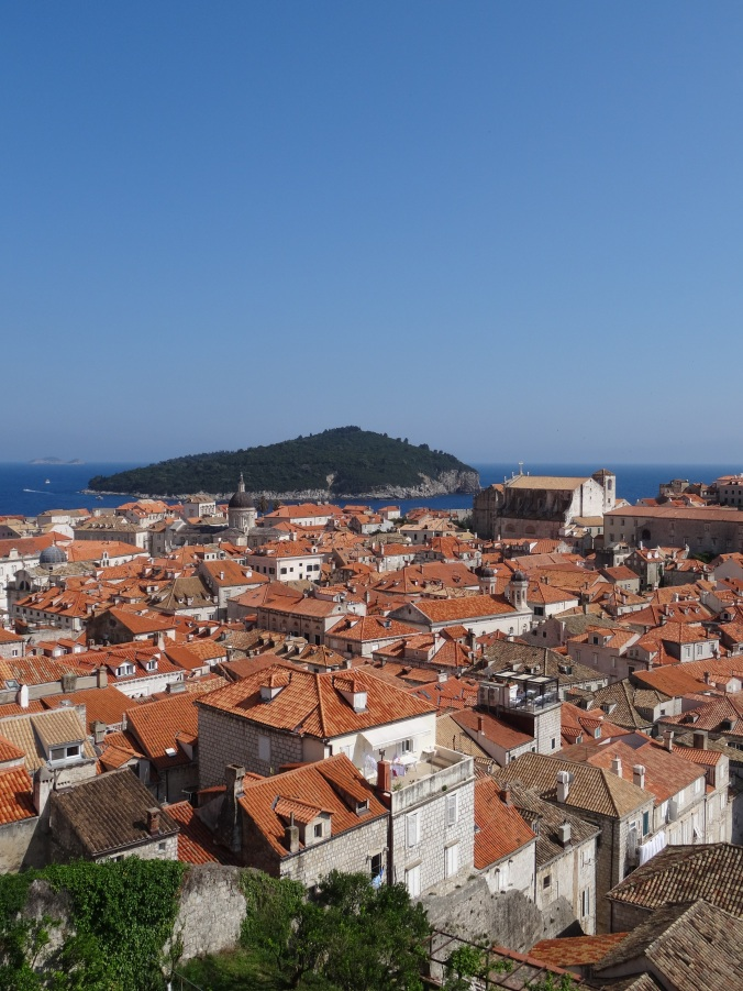 Terracotta roofs of Dubrovnik Old Town and the view out to Lokrum Island