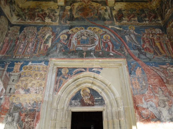 The West porch of Moldovita Monastery in Bucovina showing a 'Doom' or Last Judgement painting