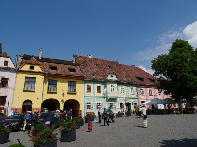 Coloured houses line a square in Sighișoara