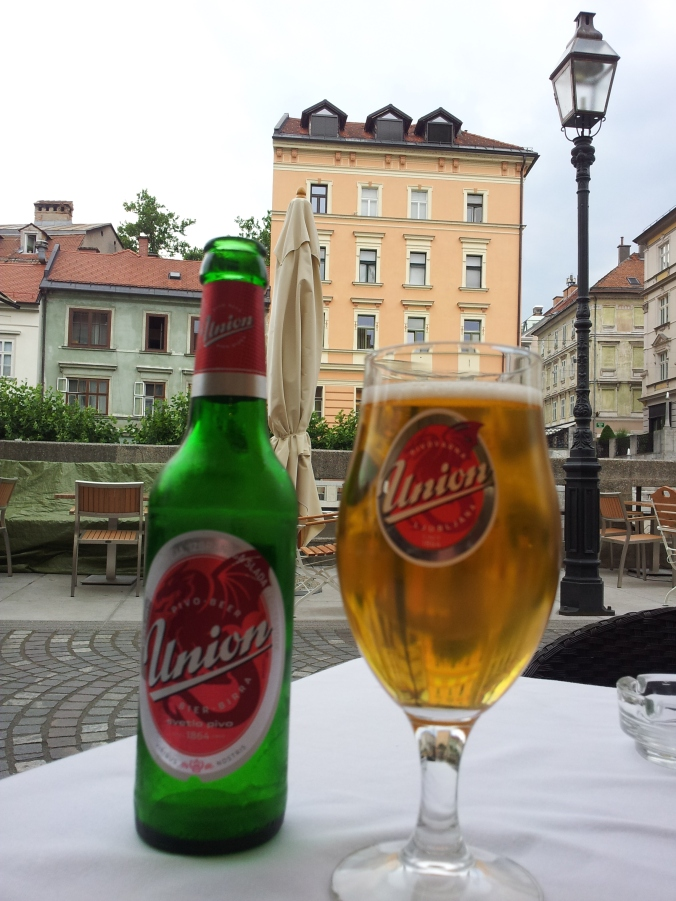 Drinking Union lager in Ljubljana