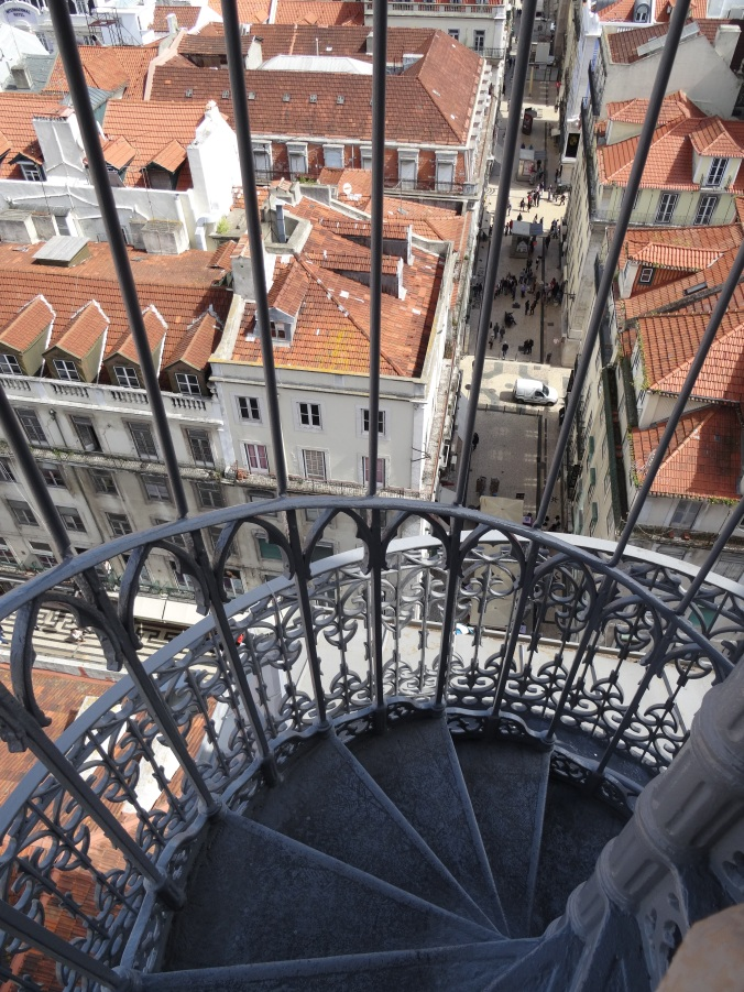View of the ornate railings of the Santa Justa lift and down into Lisbon's streets below