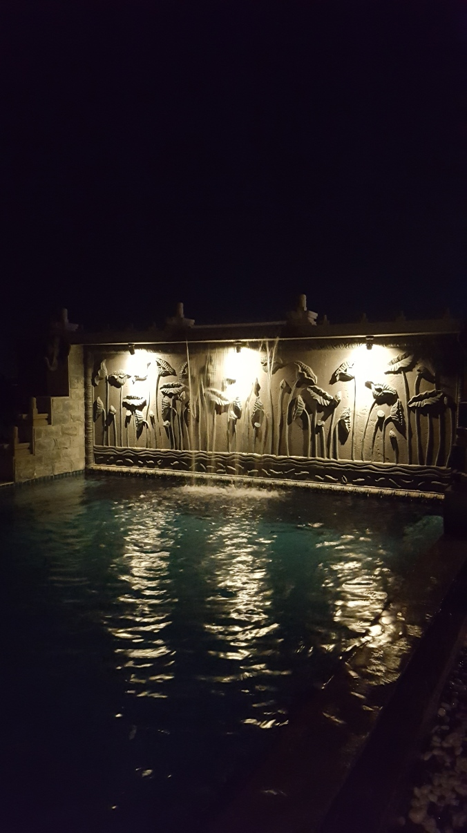 Roof top pool at night at Cyclo d'Angkor