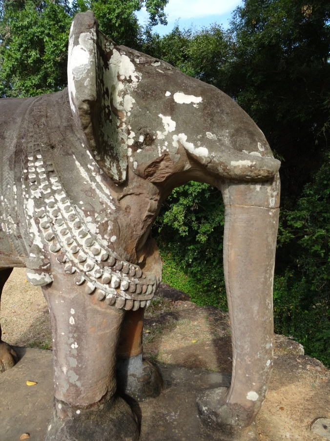 A carved elephant on the corner of the East Mebon