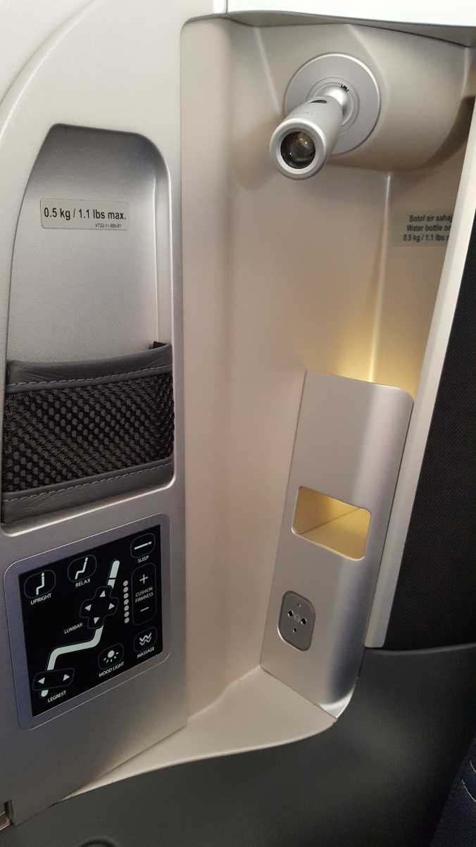 Control panel, reading light, phone storage and water bottle storage available in every seat in the Malaysia Airlines A350 business class cabin