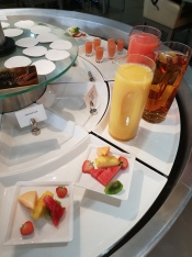Selection of juices, smoothies and fruit