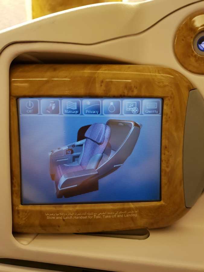 Emirates B777 business class seat recline and massage controls