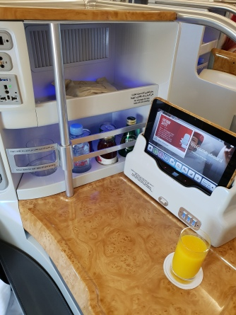 Emirates A380 business class seat console and entertainment tablet