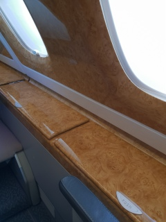 Emirates A380 business class seat side panel stowage