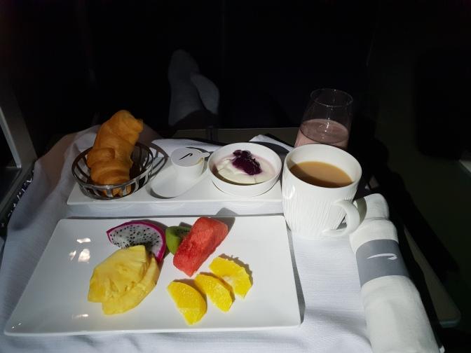 Breakfast - fruit, pastries, yoghurt and smoothie