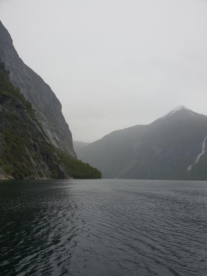 Speeding across Geirangerfjord on a RIB boat