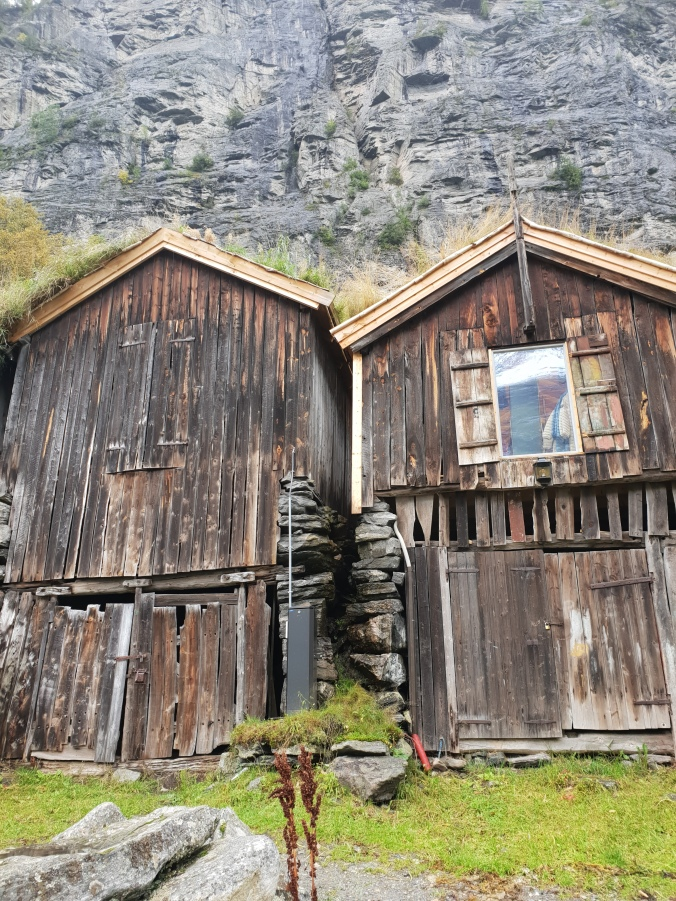 Old boathouses on the edge of Geirangerfjord