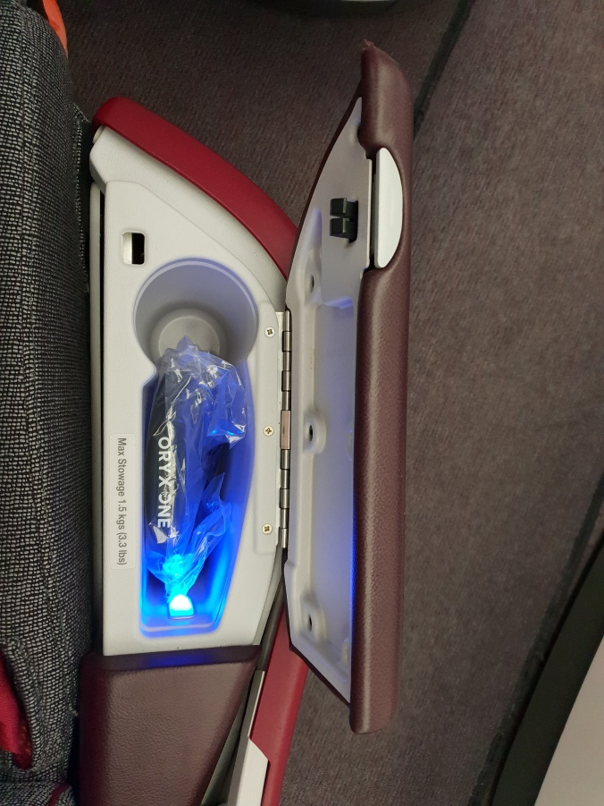Qatar Airways business class armrest storage