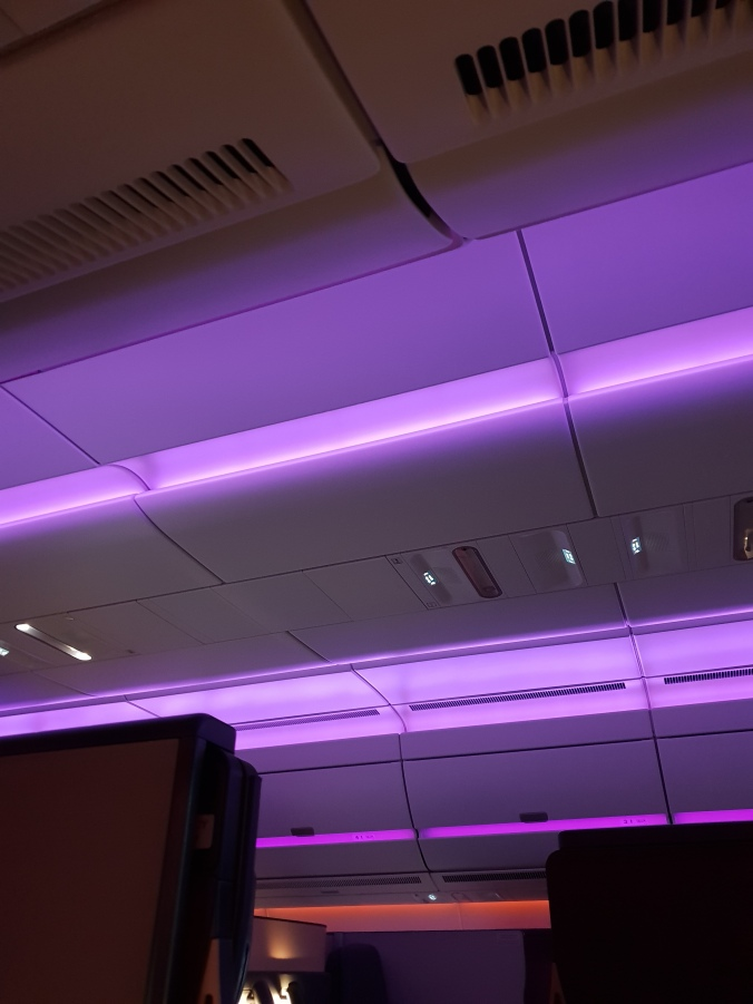 Qatar Airways business class Qsuites atmospheric lighting