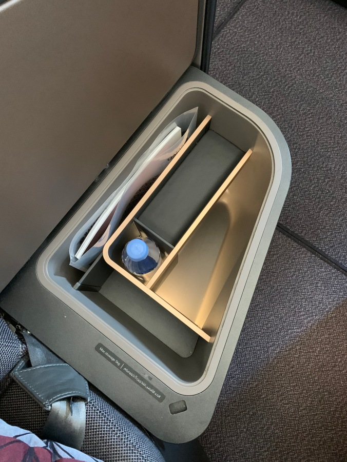 Qatar Airways business class Qsuites armrest storage