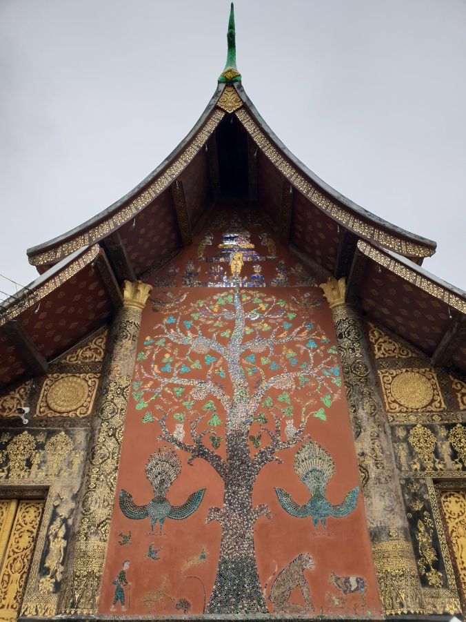 Tree of life mosaic on the ordinance hall in Wat Xieng Thong