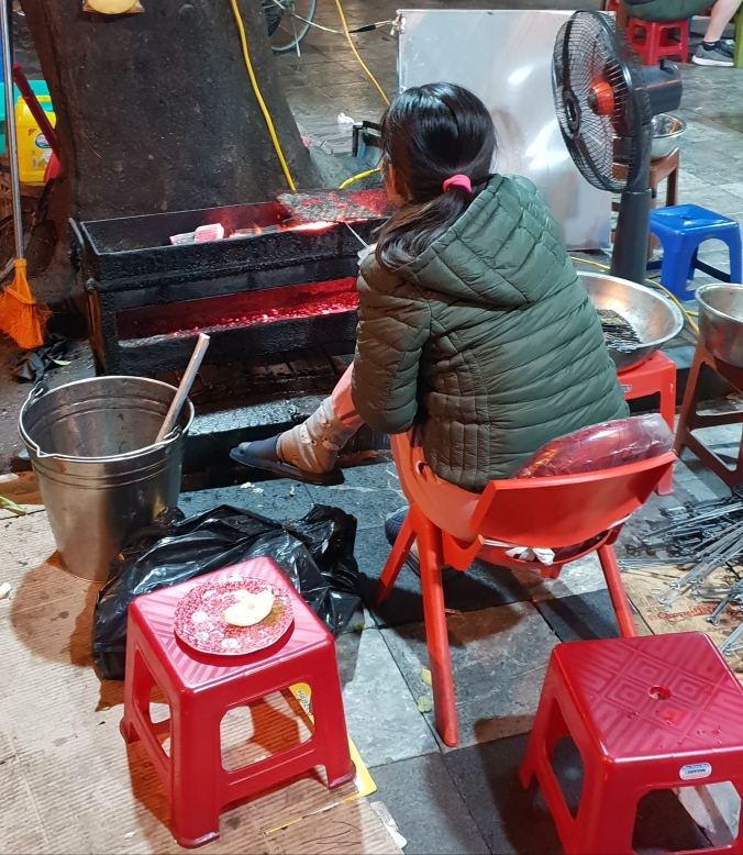 Cooking bun cha over coals