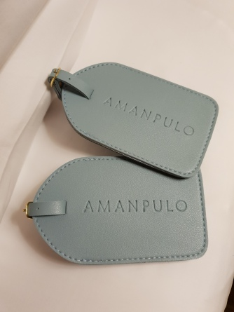 The Amanpulo luggage tags
