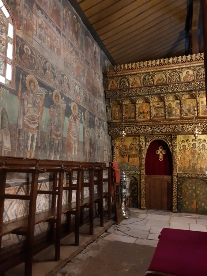 Wall paintings and iconostasis inside the church at Rozhen Monastery